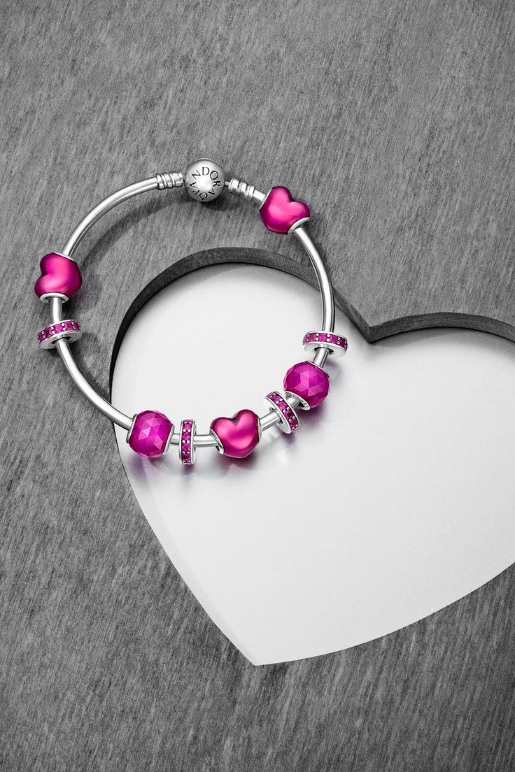 The iconic PANDORA heart is updated with a new expression thanks to the addition of a glossy violet enamel finish. Reminiscent of the shiny foil-wrapped chocolate hearts given on Valentine's Day, this sweet design will last much longer, and is sure to be a treasured keepsake of the most romantic day of the year. Soon in stores! #PANDORAbracelet #PANDORAcharm