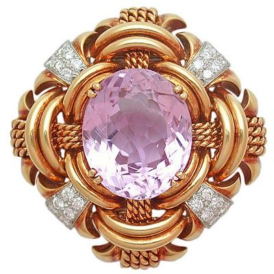Vintage David Webb brooch - The elegant, geometric brooch centering a faceted oval-cut Kunzite colored a candy pink within a domed frame of polished yellow gold arcs, twisted gold rope work, and platinum segments set with diamonds.