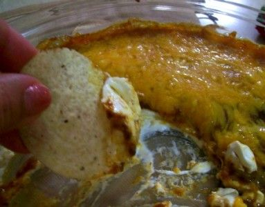 Skyline Chili Dip (3 ingredients!)   1 can of Skyline Chili (or other canned Chili of your choice)  cream cheese  shredded cheese  chips for serving
