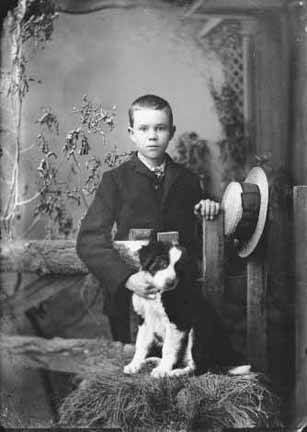 Frank Buck with his dog in the mining area of Hillsboro and Kingston, N.M. Photo by J.C. Burge, ca. 1885-1892. Palace of the Governors Photo Archives 076647.