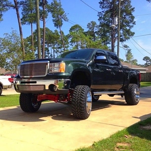 raised black gmc truck