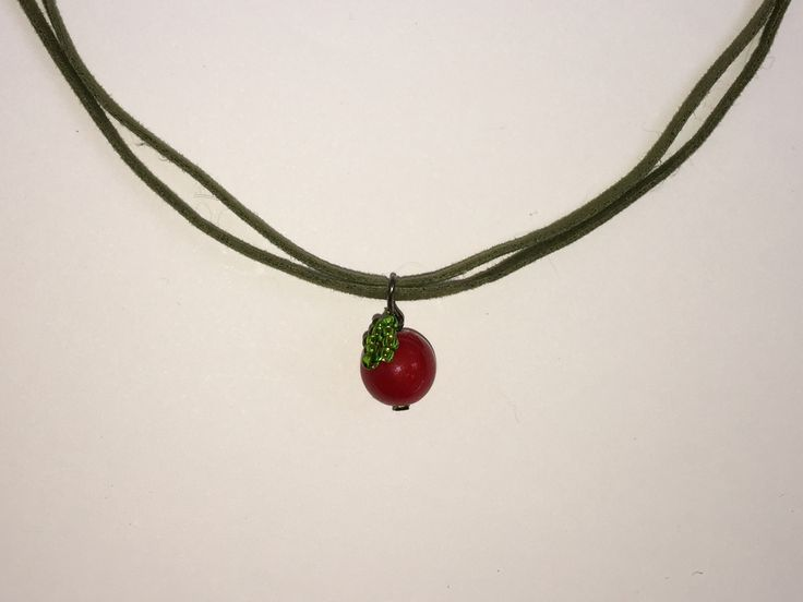 Cute little necklace - these are now being made with black waxed flat cord because the green suede doesn't pass our strength/snap test!!!    Win a necklace for FREE - follow @appletreemovie on Twitter to find out how!