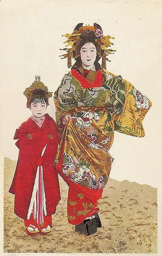 Tayuu with kamuro (by noel43), via flickr.  late 19th c hand-colored print