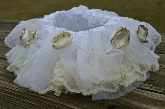 This tutu is adorned with beautiful vintage lace and accented with handmade flowers and pearl strands. All flowers are accented with pearls that have been sewn in place.