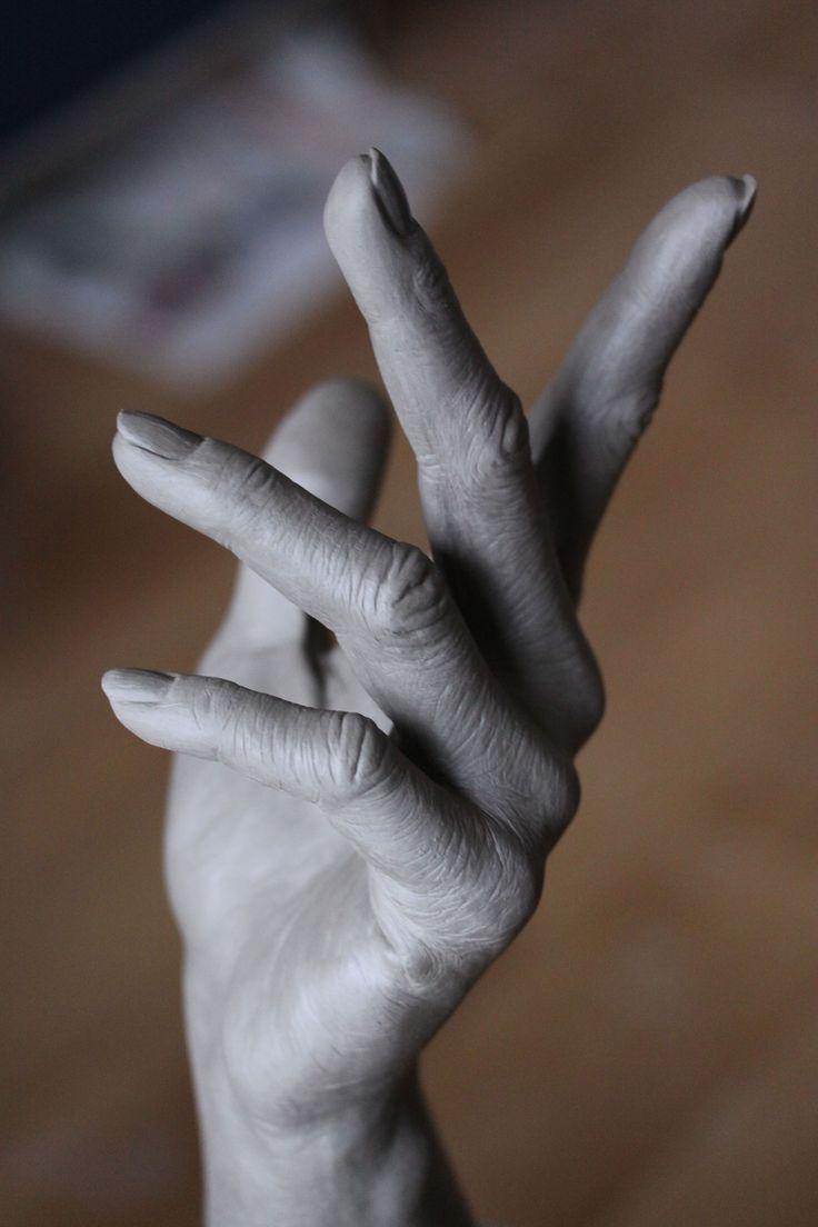 Clay Hand Sculpture: