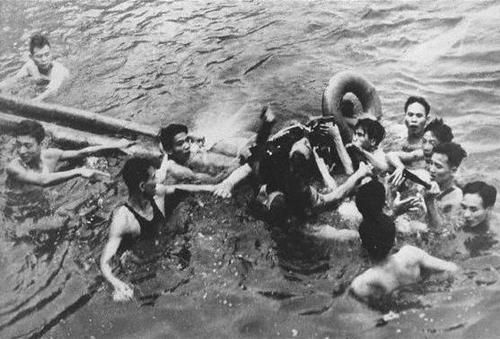 Lt. Commander John McCain being forcibly dragged from the wreckage of his A-4E Skyhawk after being shot down in the Hanoi area of North Vietnam.Though he was saved from drowning by the VC (McCain had broken his arms during his bail out), he was severely beaten once on land before being taken to the Hanoi Hilton for interrogation, where he spent 7 years as a POW