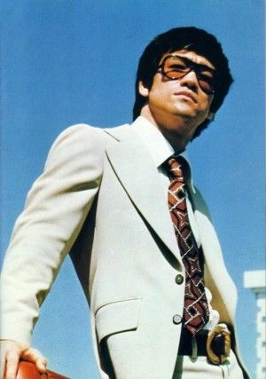 Bruce lee in a sharp suit #technicolour #readytokickbutt