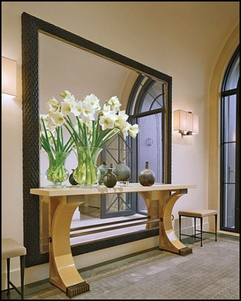 Large floor mirror with table in front