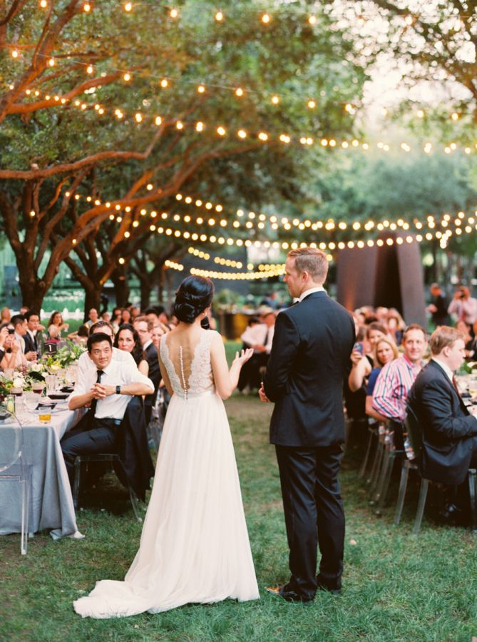Romantic string light outdoor reception: http://www.stylemepretty.com/2016/03/02/tropical-floral-inspired-spring-dallas-wedding/ | Photography: Sarah Kate Photo - http://sarahkatephoto.com/