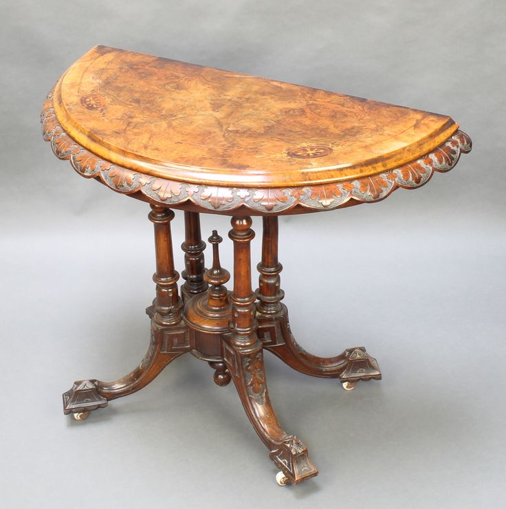 """Lot 981, A Victorian carved and figured walnut card table, raised on 4 turned supports with splayed feet 28""""h x 37""""w x 19 1/2""""d est £100-200"""