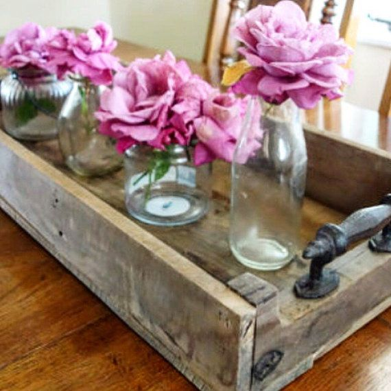 This rustic serving tray is the first of many variations my husband and I made to decorate our coffee table. We make the stain ourselves, it