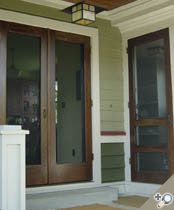 Double Manhattan screen & storm door. Shown in Solid Poplar with exterior stain/urethane by others. Browse more Traditional designs which can be made into double doors like this one.