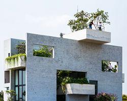 VTN architects vertically stacks gardens inside binh house in vietnam
