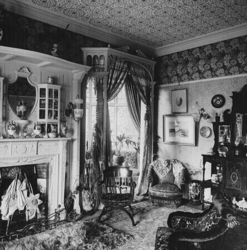 Black Celluloid | funeral-wreaths: Victorian drawing-room, 1890 with William Morris wallpaper and carpet. ~A~