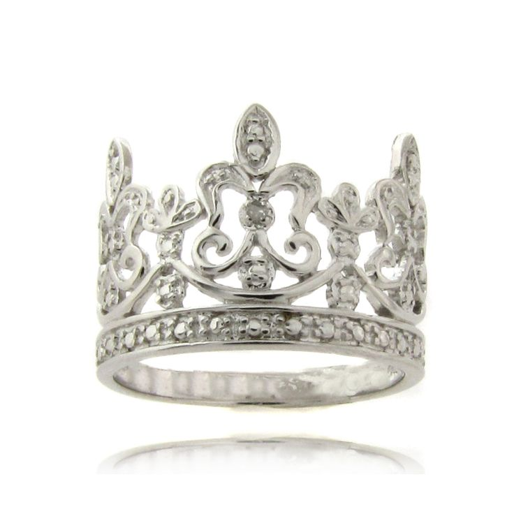 This beautiful Crown ring showcases a single genuine white diamond accent set amidst a silver pave pattern that gives the illusion of additional white stones. The ring is crafted of .925 Sterling Silver with a highly polished finish.