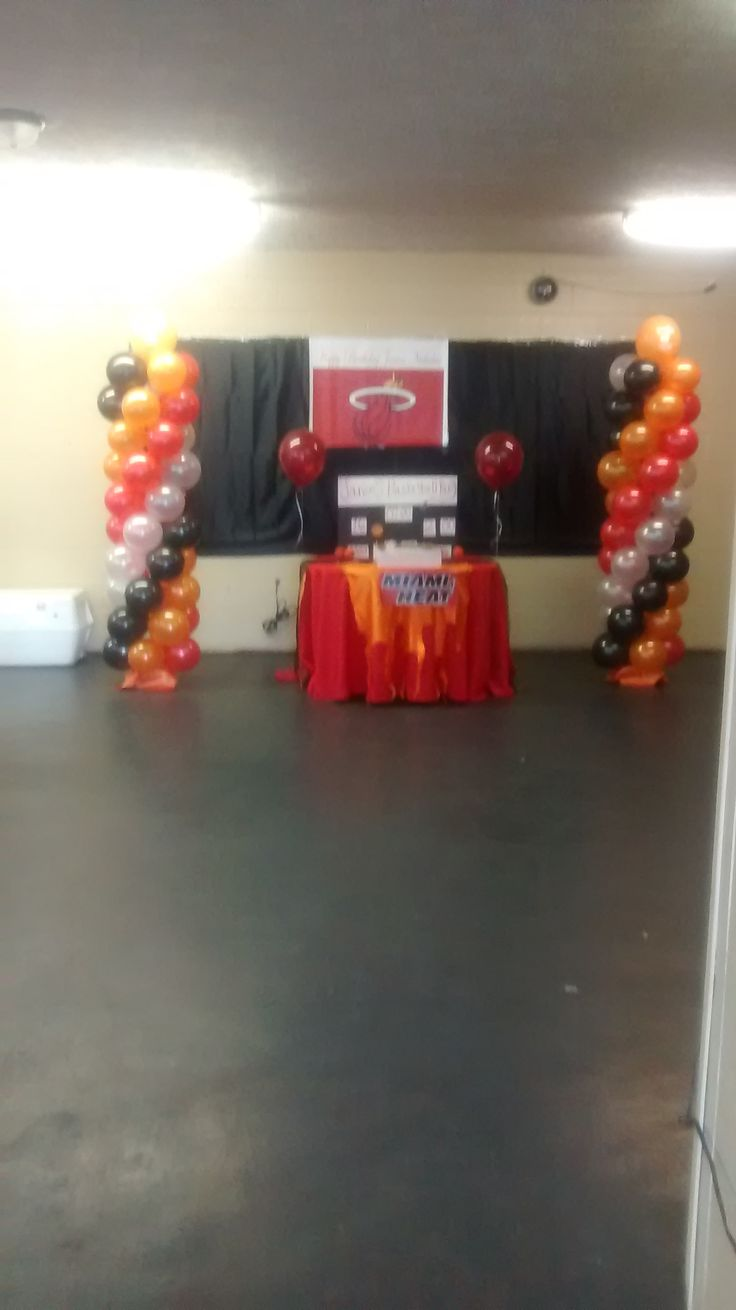 miami heat cake table with arch and backdrop