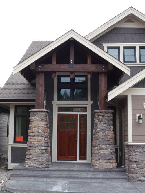 Brown Cedar Siding : Dark brown cedar beams and posts stone