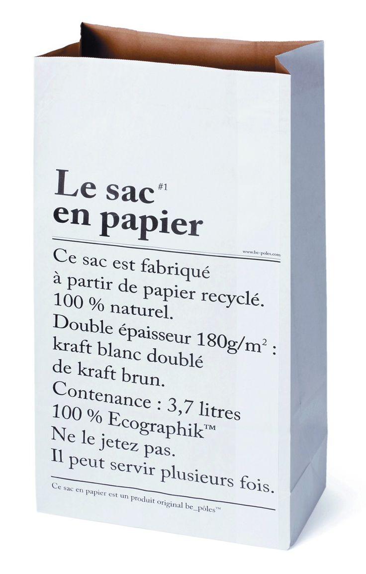 """Merci - Witte papieren zak met aan de ene kant de tekst """"Le sac en papier"""" in het Frans en aan de andere kant in het Engels. Leuk om al je kadopapier in op te bergen of om als opberger te gebruiken in de werkkamer. De zak is gemaakt van 180 grams papier en recyclebaar.  Afmetingen: 60x32 cm."""