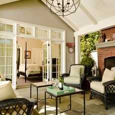 Like these French doors with windows on each side and transome windows above.  Craftsman patio by FGY Architects.