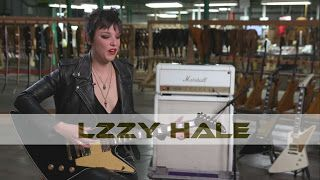 "Lzzy Hale: On Her Dark Side and Her New ""Gibson Signature Lzzy Hale Dark Explorer""    American musician Lzzy Hale is back with black. Take a look behind the scenes of her vision for the ""evil twin"" to her first Gibson signature model. Find out what her iconic inspirations were for this ""workhorse of a guitar.""  Lzzy Hale On Her Dark Side and Her New ""Gibson Signature Lzzy Hale Dark Explorer""  Lzzy Hale"