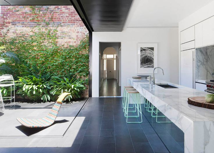 Love this modernist inspired extension by matt gibson in melbourne amazing kitchen island and