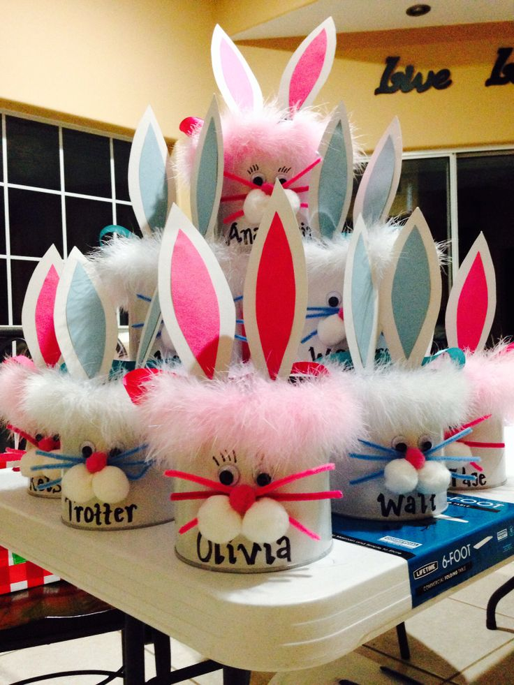 Preschool DIY Easter baskets from coffee cans for each child in your kids class. Easy! White spray paint, googlie eyes, pipe cleaners, Pom poms, fuzzy boa pieces, black sharpie, ribbon for handles (via drilled holes). Couldn't be simpler.