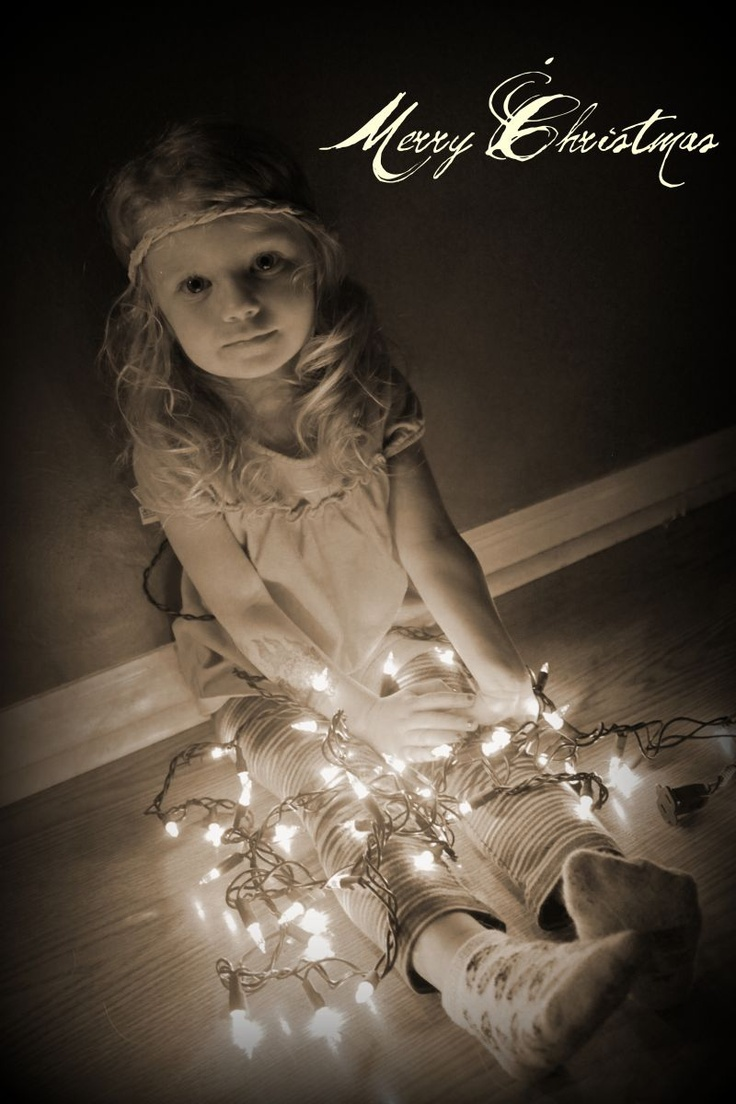 Kinda like this idea of the kids wrapped in Christmas light for a photo