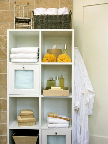 Storage Cubes- A simple cube storage unit, commonly used in home offices, can be an inexpensive way to add extra storage. Adapt a standard piece to be more bathroom-friendly by adding towel hooks and frosted cabinet doors.