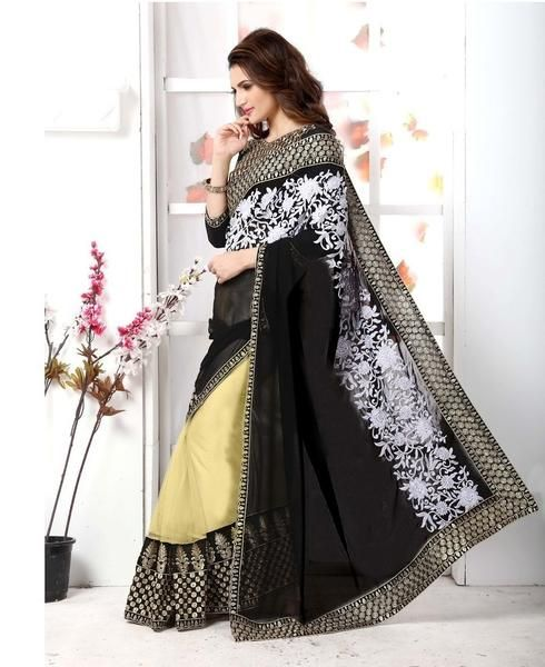 Adorned with glimmering embellishments, this elegant black half and half saree from Ladyindia is sure to elevate your ethnic style. Tailored from high quality net, it features an excellent embroidered work. Large teardrop earrings and a dainty neckpiece will go well with this saree.