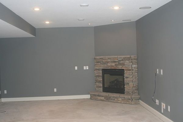 Corner basement fireplace