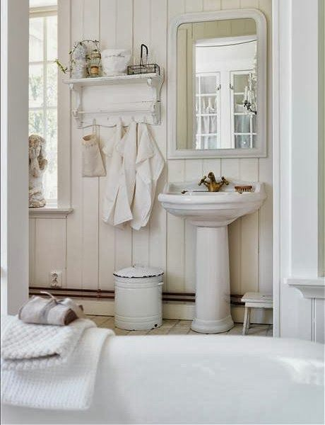 Simple White Bathroom With Ship Lap Walls Pedestal Sink And Vintage Accents