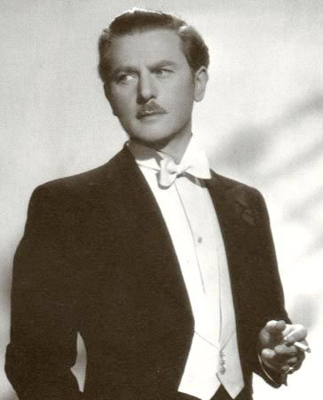 """Anton Walbrook (1896–1967) Austrian actor who settled in the UK. In 1936, he went to Hollywood to reshoot dialogue for the multinational The Soldier & the Lady (1937). Instead of returning to Austria, Walbrook, who was gay & classified under the Nuremberg Laws as """"half-Jewish"""",  settled in England & continued working as a film actor, making a speciality of playing continental Europeans. He retired from films at the end of the 1950s & in later years appeared on the European stage…"""