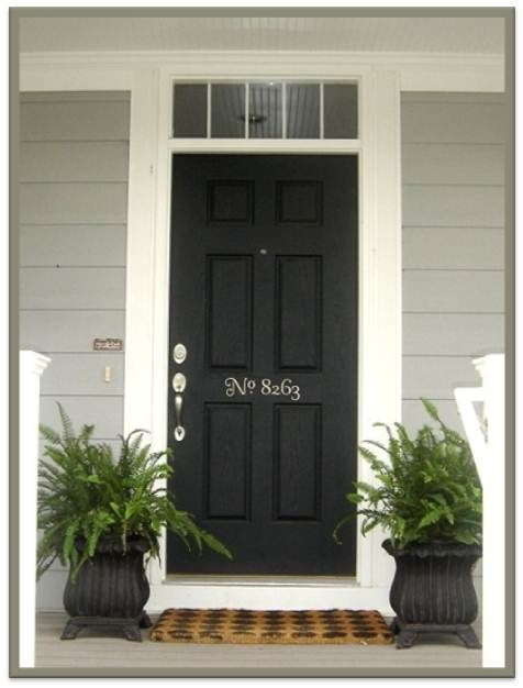 black door with number painted on