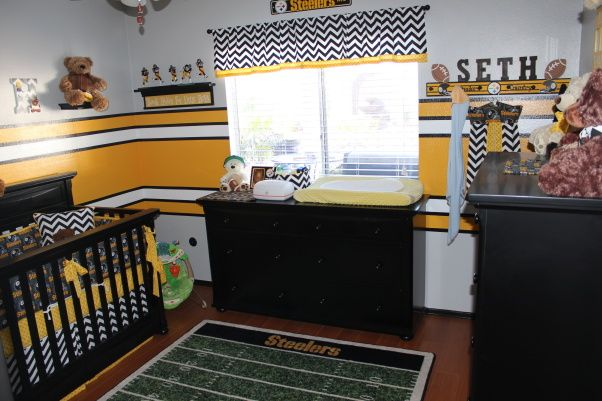 love this football themed nursery...great application for little boys room
