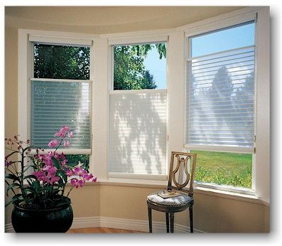 Hunter Douglas Silhouette - it's a blind, it's a shade, it's top-down/bottom-up. Perfect for a bathroom where you want light *and* privacy!