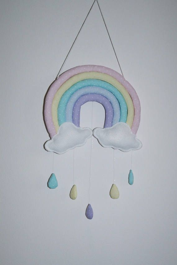 Gorgeous handmade item. Pastel rainbow with clouds and raindrops nursery mobile, wall decor, shower gift The Rainbow and the raindrops are made of pastel polka dots fabrics and the clouds are felt, they all stuffed with toy filling. The wall decor is lightweight and approximately