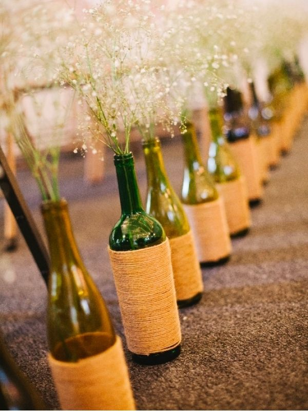 Twine wrapped bottles- perfect for center-pieces..would look so cute and eclectic with the twine wrapped mason jars with candles in them!