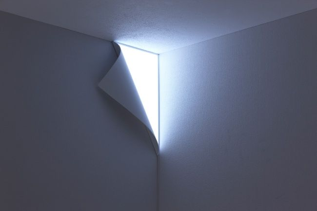 A wall light that looks as if a corner of the wall is peeling