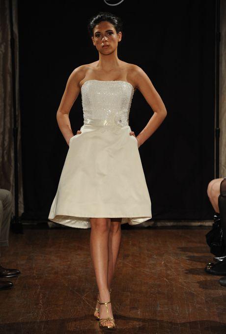 "Brides.com: Sarah Jassir - Spring 2013. ""Lou Lou"" strapless knee-length satin A-line wedding dress with a beaded bodice and floral belt, Sarah Jassir  See more Sarah Jassir wedding dresses in our gallery."