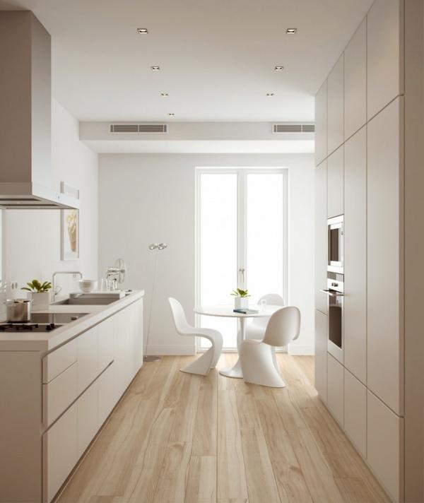 #reforma #cocina de planta alargada con 2 frentes y zona de comedor junto a la ventana, muebles blancos sin tiradores, suelo de parquet.