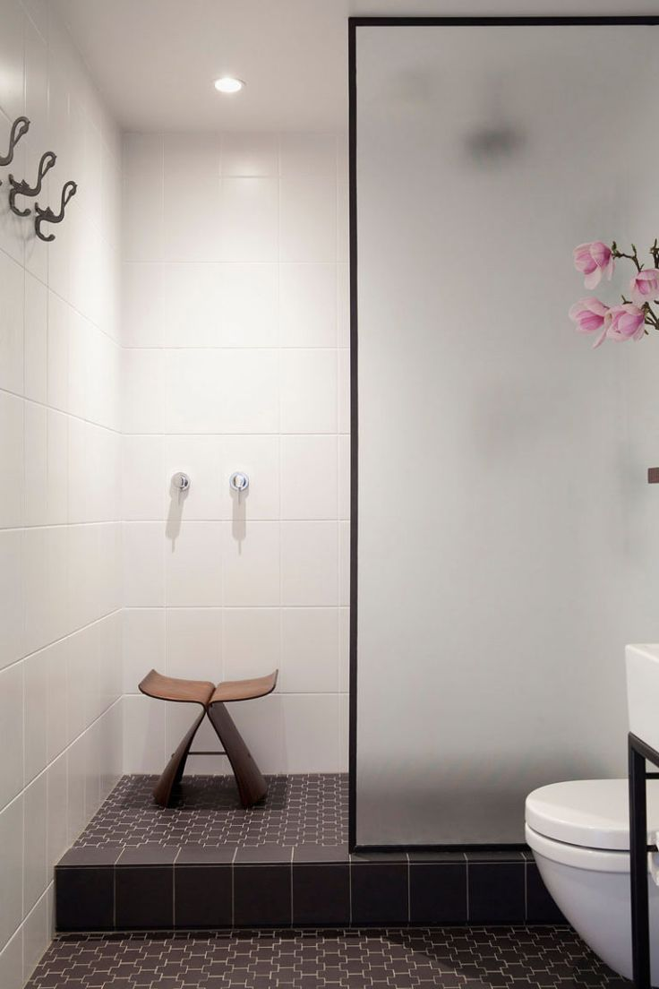 Bathroom Design Ideas - Black Shower Frames // The black frame around the frosted glass door of this shower adds a simple sophistication to the space and ties together the other black elements in the room.