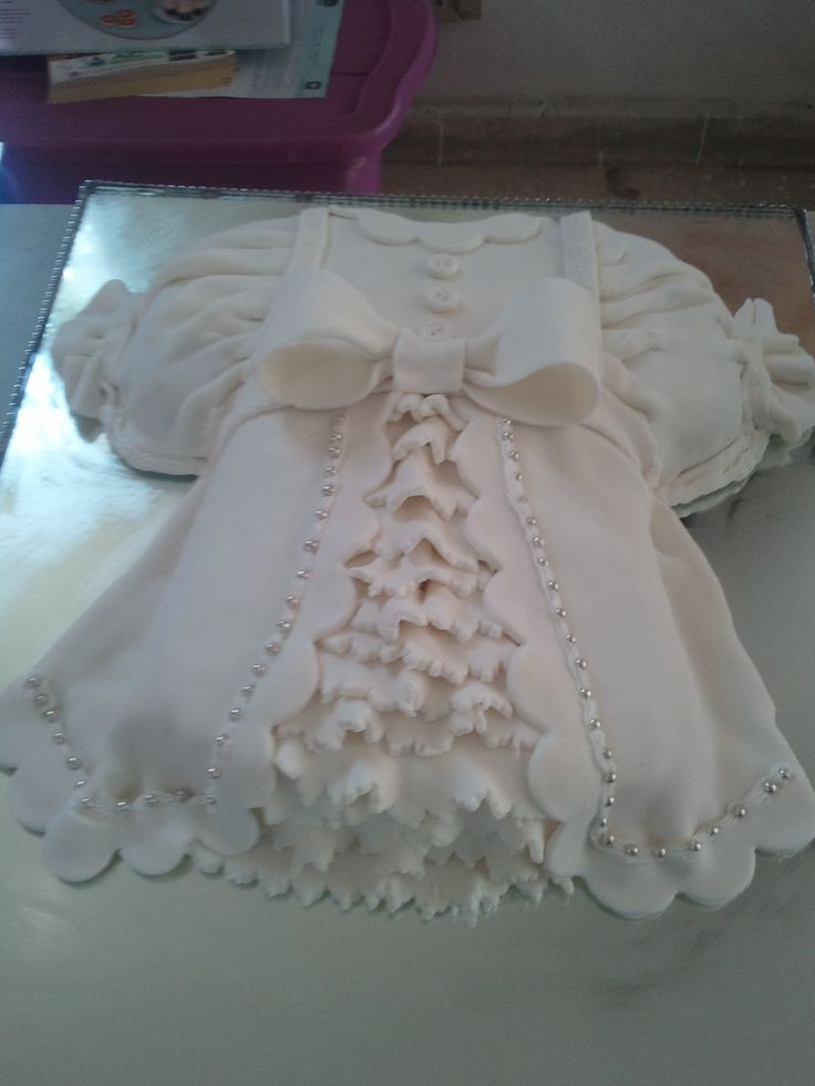It might be  Baptismal dress and it is so precious. But it doesn't look like a cake though. Cake Central does amazing work.