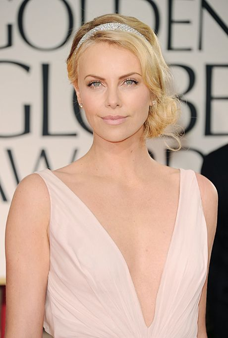 Brides.com: Wedding Beauty Inspired by The Great Gatsby. Charlize Theron's Low, Side Chignon. Before you get blinded by the utter flawlessness that is her face, note Theron's fun, vintage-inspired hairdo. The glittery headband is a glamorous addition to her low, side chignon that recalls classic '20s hairstyles. A whimsical summer wedding is a great time to sport a similar style.