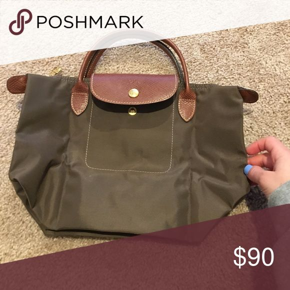 Olive green small long champ bag Olive green long champ bag with zipper length: 8.5 width: 12 in depth: 7 in Longchamp Bags Totes