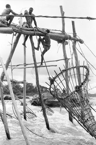Africa | Wagenia men (Enya/Genya people) with their fish-trap construction in the cataracts. Near Kisangani, Congo (Democratic Republic) |©Maya Bracher. 1970