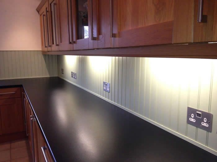 Cover kitchen tiles with tongue and groove, add under-counter lighting