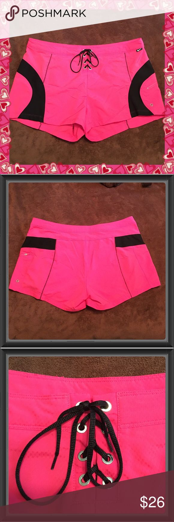 """Re-Posh New Never Worn NIKE SPHERE DRY Shorts XL Really pretty NIKE SPHERE DRY Swimsuit Cover Up shorts, New/Never worn by either party. XL (16-18) Dark Pink with Black inserts, zip up pocket & metal eyelets. Measures 19.75""""across the waist laying flat w/a 3"""" Inseam. These are super nice but I never wore them, was planning on it this summer but lost 40lbs & now they are way too big on me, I'm in a SZ 8-10 now. Pic added showing what I paid & being I never wore them either & they run anywhere…"""