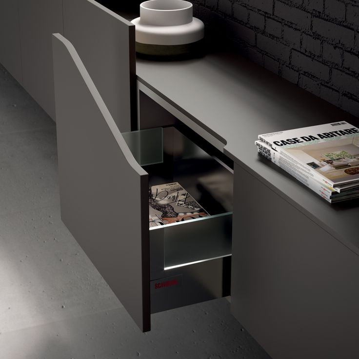 For an exclusive interior design solution for the living room, Flux Swing comes in new shaped Titanium Grey matt doors, which mark the space rhythmically in keeping with the details of the model.