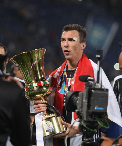 Mario Mandzukic of Juventus FC celebrates with the trophy after winning the TIM Cup Final match against SS Lazio and Juventus FC at Olimpico Stadium on May 17, 2017 in Rome, Italy.