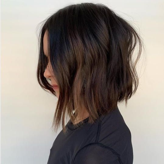 Because when you have a killer angled cut like this one by stylist Carolynn Judd, all you need is a rich chocolate brown to see you through the season. #brunette #darkhair #haircolor #southernliving